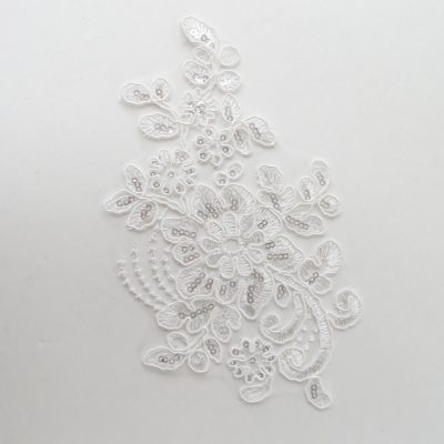 buy this white floral applique to complete your dance costume